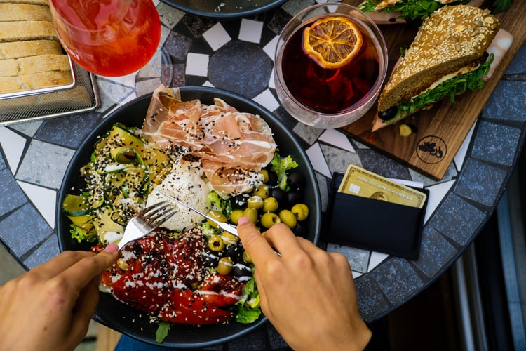 woman eating plate of salad for lunch