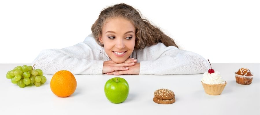 woman looking at different foods